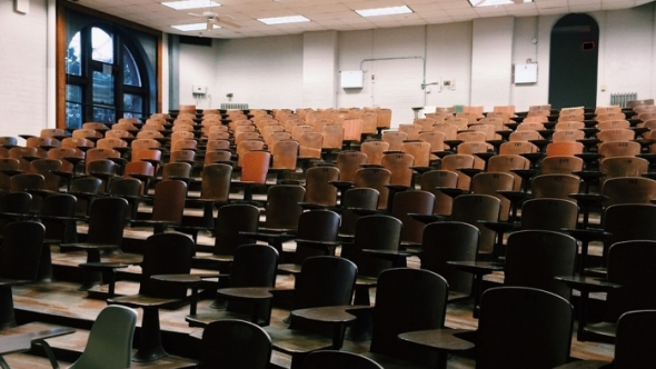 A photograph of an empty lecture hall style classroom.