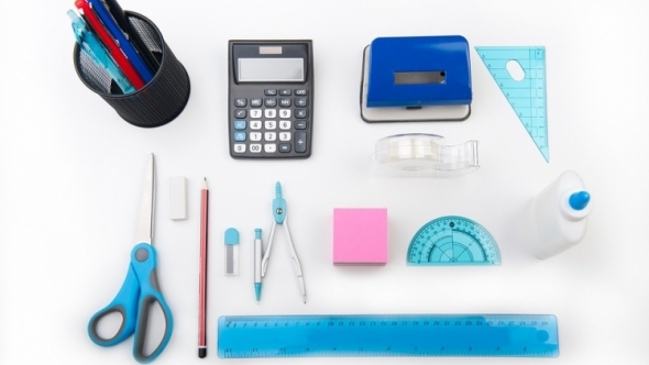 School supplies laid out on a table.
